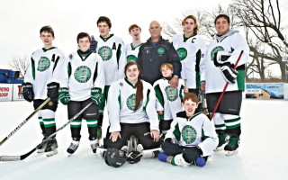 Coach Alex DePalma with members of the Brick Stars special-needs hockey team.