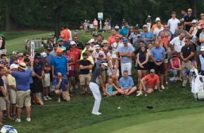 Bubba Watson chips onto the green at the 8th hole.