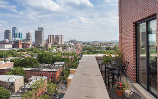 The view from Lauren Shub and Bob Eidus's penthouse apartment includes five bridges, the Statue of Liberty and downtown Jersey City.