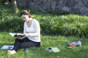 A resident reads on the Morristown Green.