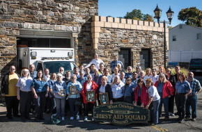 After the volunteer West Orange First Aid Squad was disbanded, its members from over the years gathered for a memorial photograph in front of the squad's castle-like headquarters.