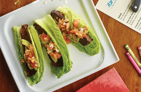 "Sofrito-braised short rib lettuce ""tacos"" with avocado and salsa."