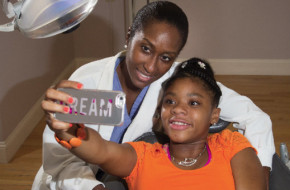 Karen Hankerson, 13, takes a selfie with Dr. Nicole McGrath at her private practice in Montclair. Photo by Andy Foster