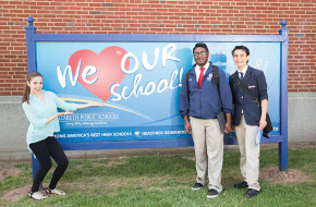 Students Alison Vieira, Kassie Mahabir and Denilson Oliveira show their Elizabeth High School pride.