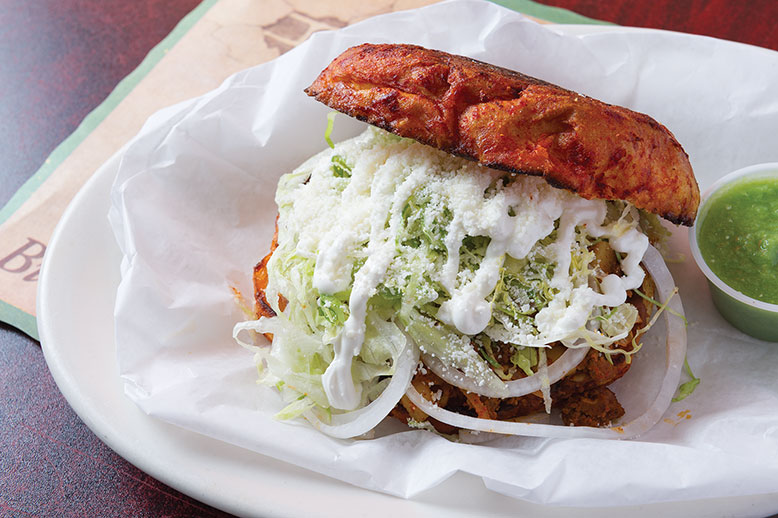The unhinge-your-jaw pambazo sandwich with signature red-sauce crust at Pancho's Mexican Grill.