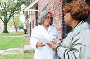 Nurse practitioner Darcel Reyes, left, confers with community health worker Barbara Robinson at Stephen Crane Village, an affordable housing community in Newark.