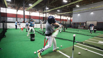 Members of the New Jersey Nationals, a North Caldwell-based club team, practice hitting off a tee during winter workouts at 360 Fitness, an indoor facility in Fairfield.