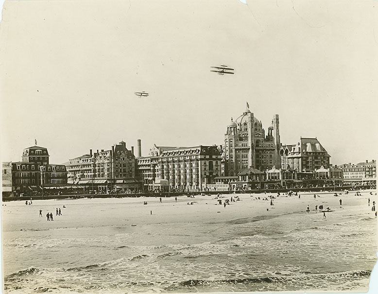 Biplanes fly over Atlantic City at the 1910 Air Carnival.