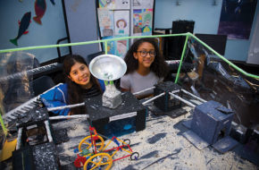 Clarissa Medina, left, and Junisse Rosario, middle school students at Newark's Ridge Street School, proudly show off their model moon colony, constructed during the city's STEM Week in June.