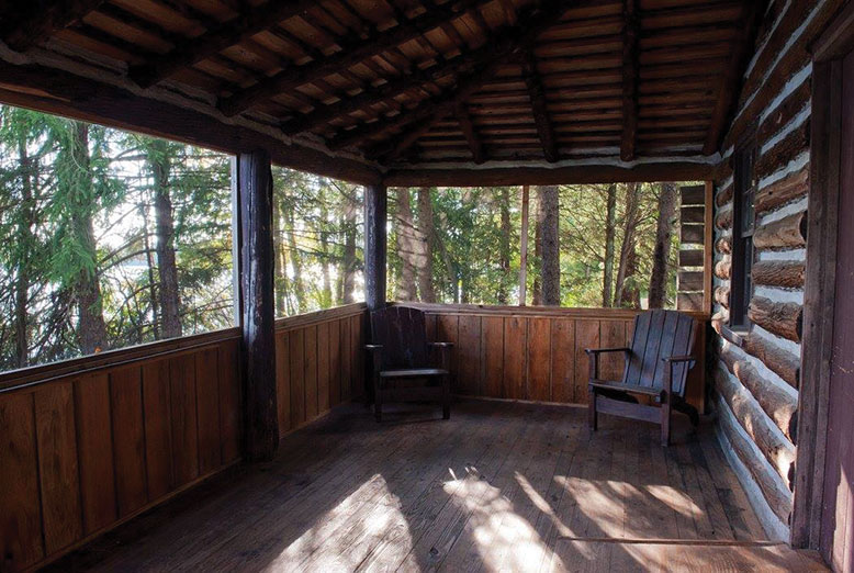 The cabins in Wharton State Forest have screened porches and look out on Atsion Lake.
