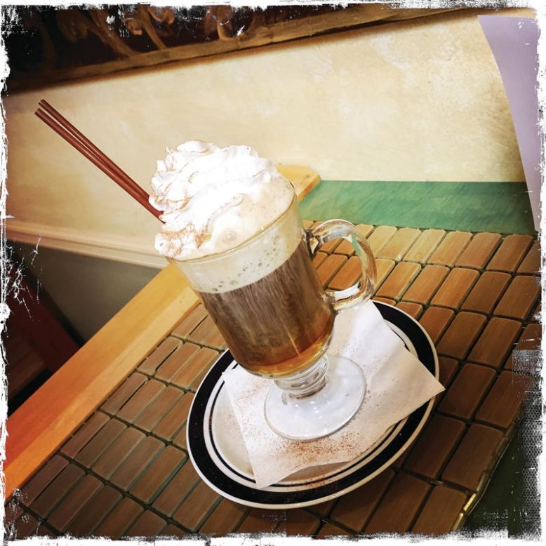 The Honey Espresso, a double espresso lavished with honey, whipped cream, cinnamon and nutmeg.