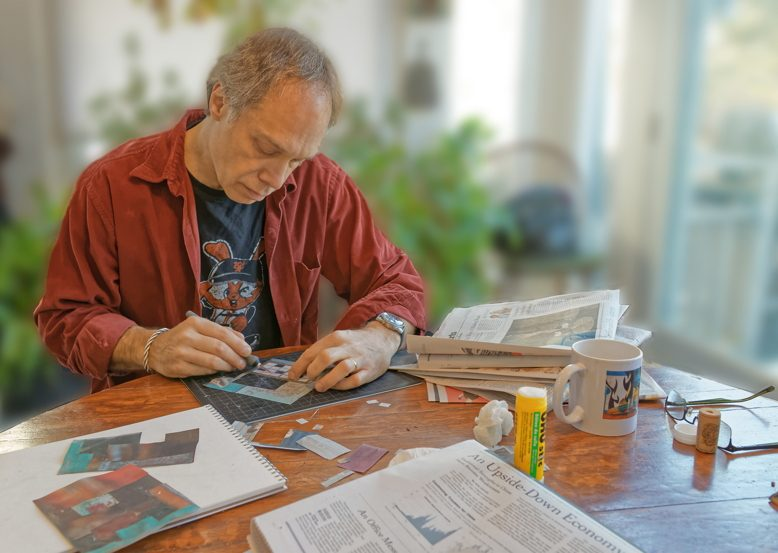 Peter Jacobs hard at work on a collage.