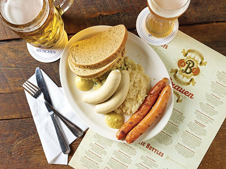 A plate of plump weisswurst, sauerkraut and frankfurters.