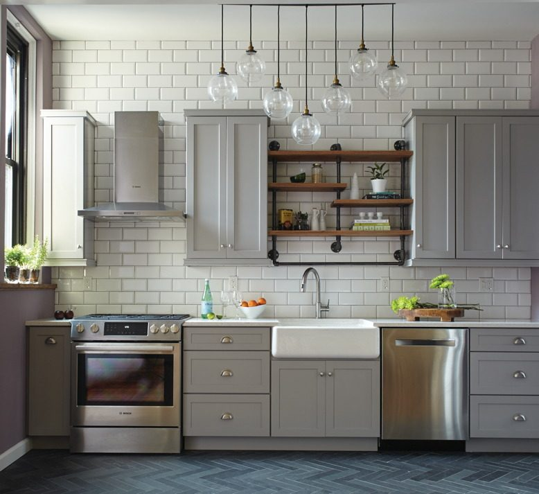 A backsplash of oversized white subway tile adds drama to Stephanie and Damian's once-cramped kitchen.
