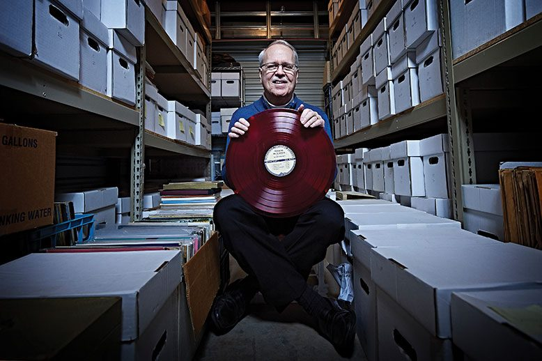 "Charlie Horner amid the archive of recordings, documents and photos he and his wife maintain to preserve the ""classic urban harmony"" they love."