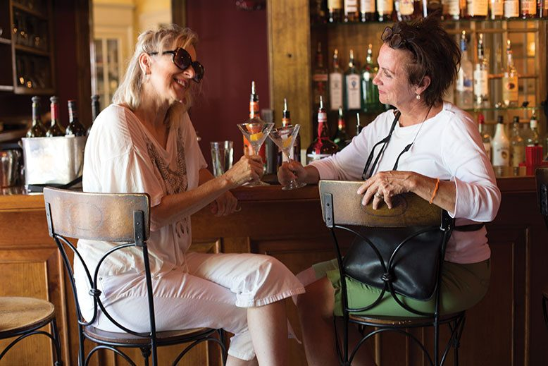 Californian Deborah Fugate, left, shares a toast with Stephanie McCue from New Hope at the Lambertville House bar.