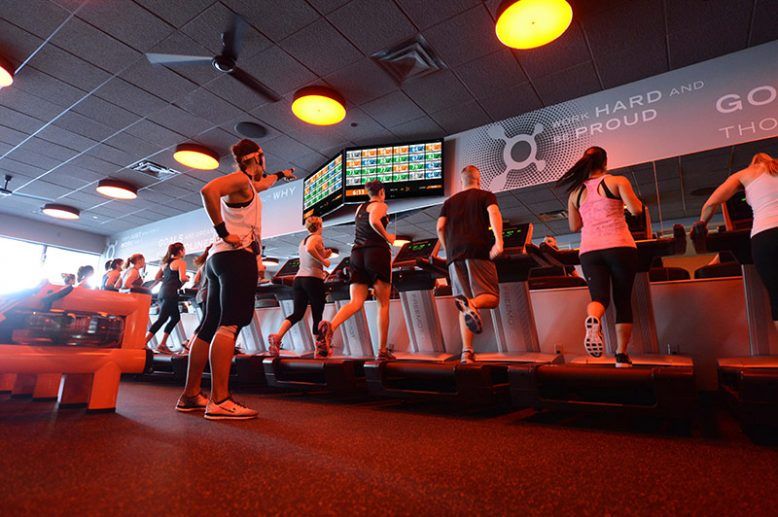 Orangetheory Fitness members on treadmills