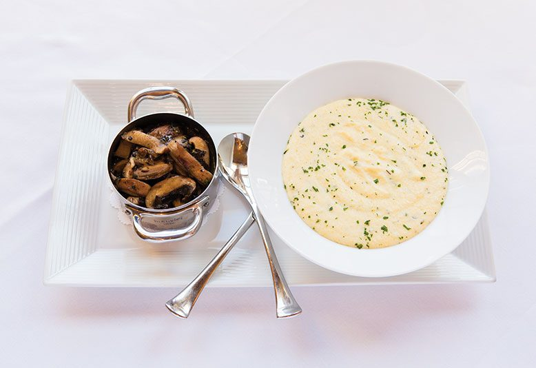 Creamy polenta with tureen of truffled mushroom fricassee.