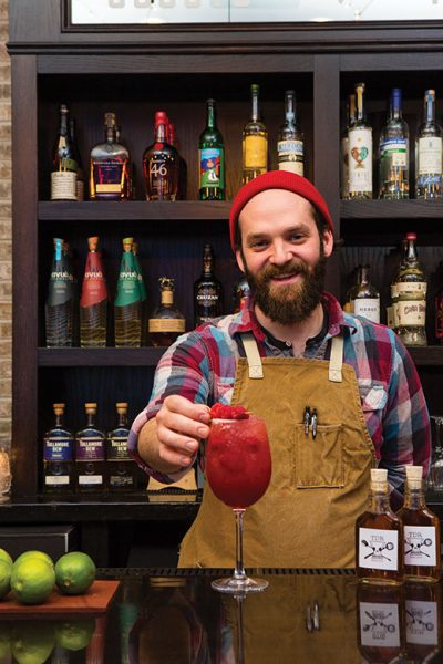 Bernard O'Connell, bar manager of the Dillinger Room in New Brunswick, proffers a Raspberry Beret.