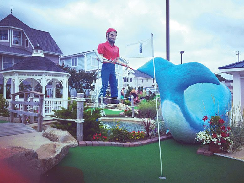 The iconic, 21-foot-tall, 495-pound, fiberglass mariner at Barnacle Bill's in Ortley Beach was stored indoors in anticipation of Hurricane Sandy but is now back on his feet, putter in hand, greeting customers.